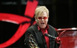 """<p>Elton John performs during a concert as part of his """"The Red Piano"""" tour at Palau Sant Jordi in Barcelona October 20, 2009 REUTERS/Marti Fradera</p>"""