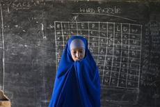 <p>A Somali refugee girl walks in front of a blackboard in a classroom at Hagadera camp in Dadaab in Kenya's northeastern province, June 4, 2009. REUTERS/Finbarr O'Reilly</p>