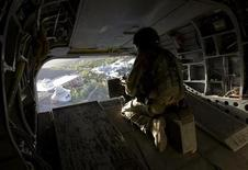 <p>A gunner of a Canadian Chinook helicopter watches from the back deck while flying over Kandahar province, southern Afghanistan March 17, 2010. REUTERS/Shamil Zhumatov</p>