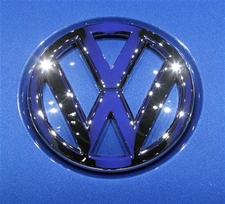 The Volkswagen logo is displayed during the second media day of the 80th Geneva Car Show at the Palexpo in Geneva March 3, 2010. REUTERS/Denis Balibouse