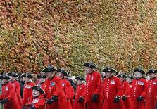 <p>Chelsea Pensioners march past a leaf-covered wall during Remembrance Sunday near the Cenotaph, in central London, in this November 12, 2006 file picture. You'd think old soldiers whose adventures have taken them from Britain's imperial frontiers of the 1930s to the Falklands of the 1980s would have earned themselves a break. But the 300 or so pensioners living in the Royal Hospital Chelsea can't afford to rest on the laurels they've earned from years of tireless service in the British Army with the future of their 17th century home at stake. Picture taken November 12, 2006. REUTERS/Toby Melville/Files</p>