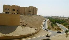 <p>A convoy of vehicles for VIPs leave the U.S. army headquarters, the former palace of ousted saddam Hussein, on the day of the visit of U.S. defence secretary Donald Rumsfeld in Tikrit, about 110 miles (180 kilometers) northwest of Baghdad September 5, 2003. REUTERS/Arko Datta</p>