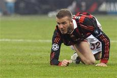 <p>AC Milan's David Beckham looks on during the Champions League soccer match against Manchester United at the San Siro stadium in Milan February 16, 2010. REUTERS/Paolo Bona</p>