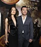 """<p>Актеры Сэм Уортингтон и Алекса Давалос позируют на премьере фильма """"Битва Титанов"""" в Голливуде 31 марта 2010 года. """"Битва титанов"""", очередной фильм, снятый на волне повального увлечения 3D-технологиями, смог с легкостью завоевать лидерство в мировом кинопрокате за прошедшие выходные. REUTERS/Mario Anzuoni</p>"""