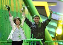 <p>Actors Tina Fey and Steve Carell gesture after they were slimed at the Nickelodeon Kids' Choice Awards in Los Angeles March 27, 2010. REUTERS/Mario Anzuoni</p>