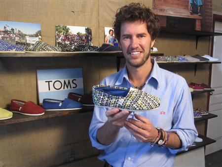 Toms Shoes Founder Blake Mycoskie Displays A Pair Of His Argentinean Inspired Canvas At Santa Monica California Office