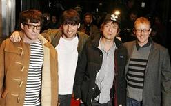 "<p>The members of Blur (L-R) Graham Coxon, Alex James, singer Damon Albarn and Dave Rowntree pose as they arrive for the world premiere of the film ""Blur : No Distance Left to Run"" in London, January 14, 2010. REUTERS/Luke MacGregor</p>"