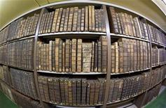 <p>The old books collection area with several rare books is seen at the Municipal Library of Lyon January 15, 2010. REUTERS/Robert Pratta</p>
