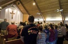 <p>Parishioners pray during a mass in Whitesville, West Virginia April 6, 2010. REUTERS/Chris Keane</p>