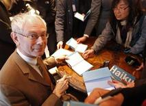 <p>The European Union's President Herman Van Rompuy signs a book collecting haiku - three-line Japanese poems of just 17 syllables - he wrote, during a ceremony in Brussels April 15, 2010. REUTERS/Yves Herman</p>