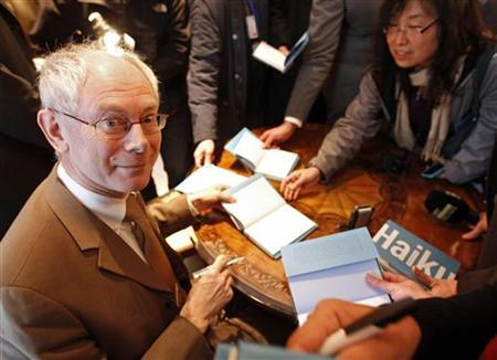 The European Union's President Herman Van Rompuy signs a book collecting haiku - three-line Japanese poems of just 17 syllables - he wrote, during a ceremony in Brussels April 15, 2010. REUTERS/Yves Herman