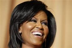 <p>First lady Michelle Obama laughs at her husband's monologue at the White House Correspondents' Association Dinner in Washington May 9, 2009. REUTERS/Jonathan Ernst</p>
