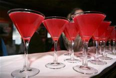 """<p>Cosmopolitan drinks line the bar during a stop on a """"Sex and the City"""" themed tour in New York May 23, 2008. REUTERS/Lucas Jackson</p>"""