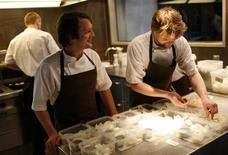 <p>Chef Rene Redzepi (L) speaks to a cook as he poses in the kitchen of his restaurant Noma in Copenhagen in this December 12, 2009 file photo. REUTERS/Christian Charisius</p>