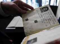 <p>Dutch Minister of Education Ronald Plasterk looks at a facsimile of Anne Frank's dairy after a news conference in Amsterdam June 11, 2009. REUTERS/Cris Toala Olivares</p>
