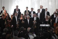 <p>Conductor Vladimir Ashkenazy (C) and members of Britain's Philharmonia Orchestra acknowledge the audience before their performance in a leper colony in Sorokdo, an island in Goheung county in the far south of South Korea, for a charity to raise awareness for treatment of Hansen's disease, May 5, 2010. REUTERS/Lee Jae-won</p>