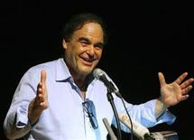 <p>Hollywood film director Oliver Stone speaks to students at the New International School of Thailand in Bangkok January 25, 2010. REUTERS/Chaiwat Subprasom</p>