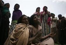 <p>Una donna in Etiopia piange la morte del figlio per malnutrizione REUTERS/Radu Sigheti</p>