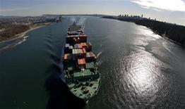 <p>A container ship departs Burrard Inlet in Vancouver, British Columbia in this March 6, 2009 file photo. REUTERS/Andy Clark</p>