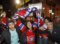 <p>Montreal Canadiens fans celebrate their team's win over the Pittsburgh Penguins in the NHL Eastern Conference semi-final series in downtown Montreal, May 12, 2010. REUTERS/Shaun Best</p>
