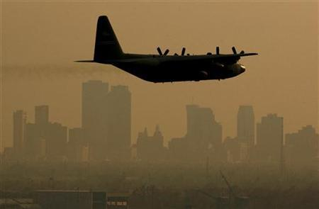 A plane disperses pesticide over parts of New Orleans, Louisiana, September 13, 2005. 	 REUTERS/Brian Snyder