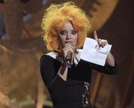 <p>British singer Lily Allen accepts the award for British female solo artist at the 30th Brit Awards ceremony at Earl's Court in London, February 16, 2010. REUTERS/Suzanne Plunkett</p>