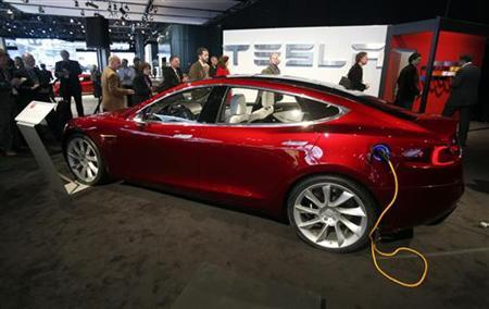 The Tesla Motors Model S Hybrid Car Is Seen Plugged In To An Electric Outlet At 2010 North American International Auto Show During Press Days Detroit