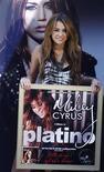 """<p>A cantora Miley Cyrus divulgestava em Madri para divulgar o lançamento de seu álbum """"Can't be tamed"""". 31/05/2010 REUTERS/Susana Vera</p>"""