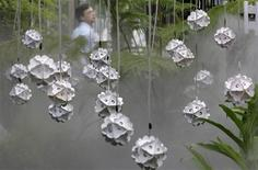 <p>A visitor walks past paper lamps at the Carton King Creativity Park in Taichung, central Taiwan May 28, 2010. REUTERS/Pichi Chuang</p>