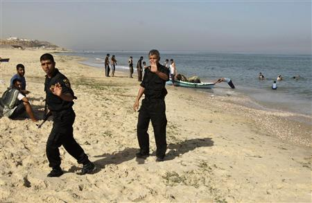 Israeli patrol kills four militants in diving suits members of hamas security forces walk on a beach in the central gaza strip after an israeli sea patrol killed palestinian militants off the gaza coast publicscrutiny Image collections