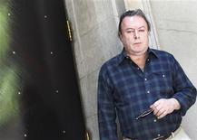 """<p>Christopher Hitchens, journalist and author of his new memoir """"Hitch 22,"""" poses for a portrait outside his hotel in New York June 7, 2010. REUTERS/Shannon Stapleton</p>"""