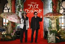 "<p>Actor Johnny Depp (L) and Director Tim Burton pose at an event to promote the movie ""Alice in Wonderland"" in Tokyo March 22, 2010. REUTERS/Kim Kyung-Hoon</p>"