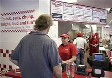 <p>A customer places an order at a Five Guys restaurant in Washington, May 26, 2010. REUTERS/Yuri Gripas</p>
