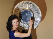 """<p>Actress Catherine Zeta-Jones, nominated for Best Performance by a Leading Actress in a Musical for her work in """"A Little Night Musical"""", signs a clock as she arrives for a Tony Award nominees press reception in New York City May 5, 2010. REUTERS/Lucas Jackson</p>"""
