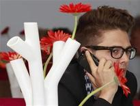 """<p>Canadian director Xavier Dolan gives a phone call during an interview for his film """"Les amours imaginaires"""" at the 63rd Cannes Film Festival May 17, 2010. REUTERS/Yves Herman</p>"""