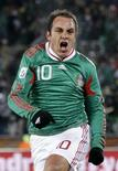<p>Mexico's Cuauhtemoc Blanco celebrates after scoring a penalty against France during a 2010 World Cup Group A soccer match at Peter Mokaba stadium in Polokwane June 17, 2010. REUTERS/Henry Romero</p>