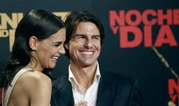 """<p>U.S. actor Tom Cruise (R) poses with his wife actress Katie Holmes during a photo call for the world premiere of his film """"Knight & Day"""" in Seville June 16, 2010. REUTERS/Juan Medina</p>"""
