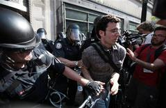 <p>Police officers clash with a demonstrator during a protest ahead of the G20 Summit in downtown Toronto June 25, 2010. REUTERS/Mark Blinch</p>