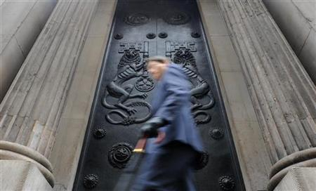 A man passes a doorway at the Bank of England in the City of London February 4, 2010. REUTERS/Toby Melville