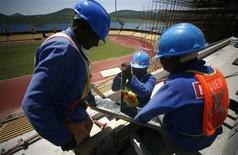 <p>Workers cut wood during the modernisation work at the Royal Bafokeng Stadium in Rustenberg November 25, 2008. The venue will be used for the 2009 Confederation Cup and for 2010 FIFA World Cup. REUTERS/Radu Sigheti</p>