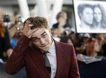 """<p>Cast member Robert Pattinson poses at the premiere of """"The Twilight Saga: Eclipse"""" during the Los Angeles Film Festival at Nokia theatre at L.A. Live in Los Angeles June 24, 2010. REUTERS/Mario Anzuoni</p>"""