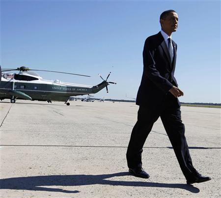 U.S. President Barack Obama departs the Andrews Air Force Base outside Washington for the memorial service for U.S. Senator Robert Byrd in West Virginia after speaking about monthly employment numbers and the Recovery Act July 2, 2010. REUTERS/Larry Downing