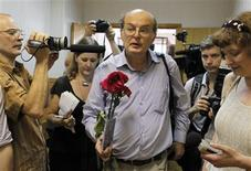 <p>Russian curator Yuri Samodurov leaves the courtroom in Moscow July 12, 2010. REUTERS/Denis Sinyakov</p>