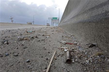 A spent shell casing lies alongside the road on Danziger Bridge in eastern New Orleans, Louisiana November 10, 2005. REUTERS/Lucas Jackson
