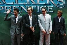 """<p>Cast members Jay Baruchel (L) and Nicolas Cage (2nd L), director Jon Turteltaub (2nd R) and producer Jerry Bruckheimer pose as they arrive at the world premiere of """"The Sorcerer's Apprentice"""" in New York July 6, 2010. REUTERS/Eric Thayer</p>"""
