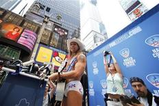 "<p>Robert Burck, a street performer known as the ""Naked Cowboy"", declares his candidacy for Mayor of New York in Times Square July 22, 2009. REUTERS/Lucas Jackson</p>"