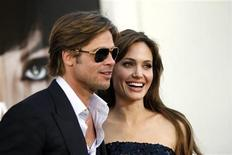 """<p>Cast member Angelina Jolie and actor Brad Pitt pose at the premiere of the movie """"Salt"""" at the Grauman's Chinese theatre in Hollywood, California July 19, 2010. REUTERS/Mario Anzuoni</p>"""