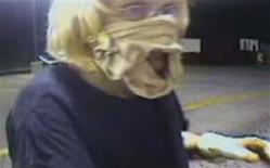 <p>A video grab shows Sharon Lain, with a woman's girdle wrapped around her face as a make-shift mask, robbing an Oklahoma McDonald's. Lain, 51, an unemployed woman who said she was desperate for money has been arrested on charges she robbed the McDonald's. REUTERS/Midwest City Police Department/Handout</p>