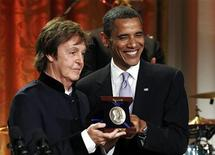 <p>President Barack Obama smiles next to Paul McCartney at the White House in Washington June 2, 2010. REUTERS/Kevin Lamarque</p>