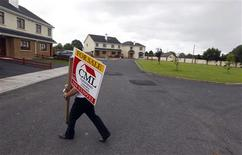 <p>Property developer Johnny Owens does odd jobs around his practically deserted housing development, in Mullingar, Ireland, July 28, 2010. REUTERS/Cathal McNaughton</p>